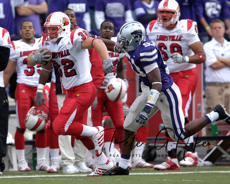 Louisville running back Brock Bolen (32) rushes down the sideline for a first down, as Kansas State's Zach Diles (53) comes in from behind at Bill Snyder Family Stadium in Manhattan, Kansas, September 23, 2006.  The 8th ranked Louisville Cardinals beat K-State 24-6.