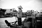 A woman heads toward a floating market in the Mekong Delta region of Vietnam.