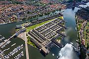 Nederland, Noord-Holland, Zaandam, 14-06-2012; Zaaneiland, gelegen in de monding van rivier de Zaan, tussen Voorzaan en de Oude Haven. Vroeger ingebruik bij de houtindustrie, o.a. houtwerven. Nieuwe woonwijk op eiland, waterstad. <br /> New residential area on former industrial area on island on the river Zaan in Zaandam.<br /> luchtfoto (toeslag), aerial photo (additional fee required)<br /> foto/photo Siebe Swart