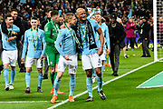Oleksandr Zinchenko and Vincent Kompany (4) of Manchester City celebrate at full time while on their lap of honour after the 3-0 win over Arsenal during the EFL Cup Final match between Arsenal and Manchester City at Wembley Stadium, London, England on 25 February 2018. Picture by Graham Hunt.