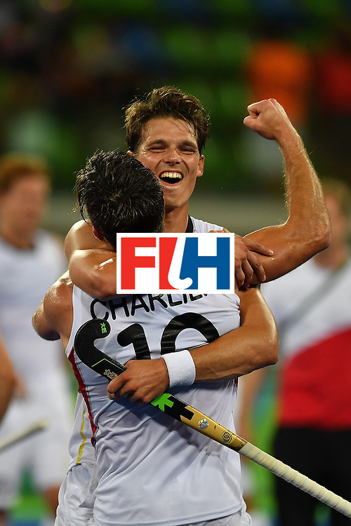 RIO DE JANEIRO, BRAZIL - AUGUST 16:  Players of the Belgium hockey team Felix Denayer and Cedric Charlier celebrate after their win of the Men's semifinal hockey match Belgium vs Netherlands at the Olympic Hockey centre on August 16, 2016 in Rio de Janeiro, Brazil.  (Photo by Pascal Le Segretain/Getty Images)