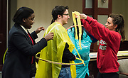 Scott Miller, Washington Hall Resident Director, gets 'dressed' by volunteers for the formal attire round of the Faculty Pageant.