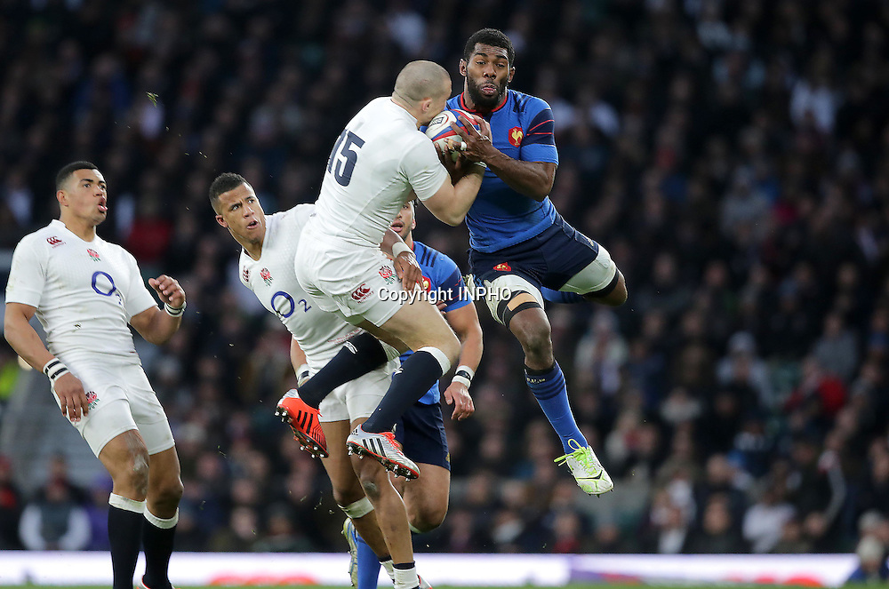 RBS 6 Nations Championship, Twickenham Stadium, London, England 21/3/2015<br /> England vs France<br /> England's Mike Brown with Noa Nakaitaci of France<br /> Mandatory Credit &copy;INPHO/Morgan Treacy