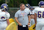 UPPER MORELAND, PA - SEPTEMBER 16: Coach Adam Beach directs the defense during a drill at football practice at Upper Moreland High School September 16, 2014 in Upper Moreland, Pennsylvania. Upper Moreland is off to a 3-0 start and has been playing well. (Photo by William Thomas Cain/Cain Images)