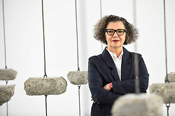 """© Licensed to London News Pictures. 11/09/2019. LONDON, UK. Artist Mona Hatoum stands within her work """"Remains to be Seen"""", 2019. Preview of """"Remains to be Seen"""", a new exhibition by Mona Hatoum at White Cube gallery in Bermondsey.  This is the first presentation of her work since Tate Modern in 2016.  The show runs 12 September to 3 November 2019.  Photo credit: Stephen Chung/LNP"""