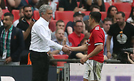 Manchester United manager Jose Mourinho (left) and Alexis Sanchez shake hands