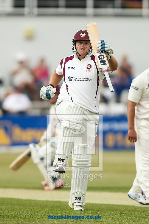 Richard Levi of Northamptonshire celebrates reaching his century during the LV County Championship Div Two match at the County Ground, Northampton<br /> Picture by Andy Kearns/Focus Images Ltd 0781 864 4264<br /> 08/06/2015