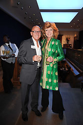 Artist GARY HODGES and actress RULA LENSKA at an auction and priavte view of paintings, drawings, stories and doodles by well known personalities held at Christie's, St.James's, London on 20th September 2010.