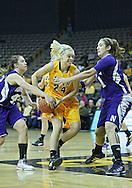 December 30, 2011: Iowa Hawkeyes guard Jaime Printy (24) tries to drive between Northwestern Wildcats guard Karly Roser (42) and Northwestern Wildcats forward/center Dannielle Diamant (31) during the NCAA women's basketball game between the Northwestern Wildcats and the Iowa Hawkeyes at Carver-Hawkeye Arena in Iowa City, Iowa on Wednesday, December 30, 2011.