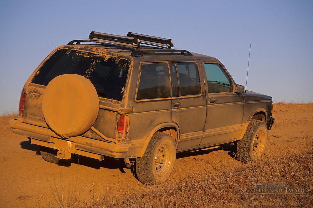 1994 Chevy Blazer 4WD SUV covered in dirt on Palassou Ridge, Santa Clara County, California