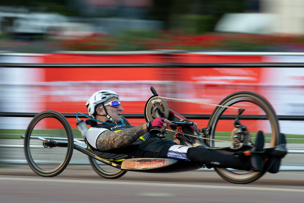 In-camera slow shutter speed pan used in this photo of Competitors racing past Buckingham Palace in The Prudential RideLondon Handcycle Grand Prix. Saturday 28th July 2018<br /> <br /> Photo: Jed Leicester for Prudential RideLondon<br /> <br /> Prudential RideLondon is the world's greatest festival of cycling, involving 100,000+ cyclists - from Olympic champions to a free family fun ride - riding in events over closed roads in London and Surrey over the weekend of 28th and 29th July 2018<br /> <br /> See www.PrudentialRideLondon.co.uk for more.<br /> <br /> For further information: media@londonmarathonevents.co.uk