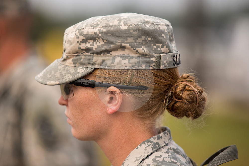 The hair bun of a female Drill Sergeant candidate show from under her hat at the US Army Drill Instructors School Fort Jackson during formation September 26, 2013 in Columbia, SC. While 14 percent of the Army is women soldiers there is a shortage of female Drill Sergeants.