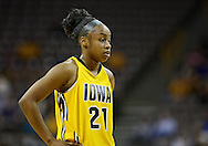 February 24 2011: Iowa Hawkeyes guard Kachine Alexander (21) during the first half of an NCAA women's college basketball game at Carver-Hawkeye Arena in Iowa City, Iowa on February 24, 2011. Iowa defeated Illinois 83-64.