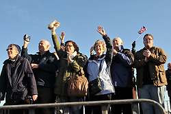 Licensed to London News Pictures. 11/01/2012. Portsmouth, UK. Locals and family of crew wave to New Royal Navy destroyer - HMS Daring leaving Royal Navy Base in Portsmouth for it's deployment to Middle East on January 11th, 2012. Photo credit: Christopher Gretkus/LNP