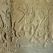 This bas relief is one of hundreds carved into the walls of the temple at Angkor Wat.  Many of the bas reliefs depict stories or events.  It really makes the mind wander as you walk through the temple complex and take in all of the magnificent carvings.<br /> <br /> Angkor Wat (Khmer: អង្គរវត្ត) was first a Hindu, later a Buddhist, temple complex in Cambodia and the largest religious monument in the world. The temple was built by the Khmer King Suryavarman II in the early 12th century in Yaśodharapura (Khmer: យសោធរបុរៈ, present-day Angkor), the capital of the Khmer Empire, as his state temple and eventual mausoleum. Breaking from the Shaiva tradition of previous kings, Angkor Wat was instead dedicated to Vishnu. As the best-preserved temple at the site, it is the only one to have remained a significant religious center since its foundation. The temple is at the top of the high classical style of Khmer architecture. It has become a symbol of Cambodia, appearing on its national flag, and it is the country's prime attraction for visitors.<br /> <br /> Angkor Wat combines two basic plans of Khmer temple architecture: the temple-mountain and the later galleried temple, based on early Dravidian architecture, with key features such as the Jagati. It is designed to represent Mount Meru, home of the devas in Hindu mythology: within a moat and an outer wall 3.6 kilometres (2.2 mi) long are three rectangular galleries, each raised above the next. At the centre of the temple stands a quincunx of towers. Unlike most Angkorian temples, Angkor Wat is oriented to the west; scholars are divided as to the significance of this. The temple is admired for the grandeur and harmony of the architecture, its extensive bas-reliefs, and for the numerous devatas adorning its walls.<br /> <br /> The modern name, Angkor Wat, means &quot;Temple City&quot; or &quot;City of Temples&quot; in Khmer; Angkor, meaning &quot;city&quot; or &quot;capital city&quot;, is a vernacular form of the word nokor (