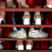 An Odessa High graduate's shoes make a statement of individuality  during a class picture just minutes before walking across the stage.