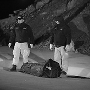 Members of a Mexican forensics team stands by a body bag which contains the body of a woman who was shot in the head on the outskirts of Ciudad Juarez in Chihuahua, Mexico which is an area infamous for many gruesome murders of women..(Credit Image: © Louie Palu/ZUMA Press).December 2011