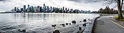 Downtown Vancouver skyline reflects in Coal Harbour at Stanley Park, British Columbia, Canada. This panorama was stitched from 5 overlapping images.
