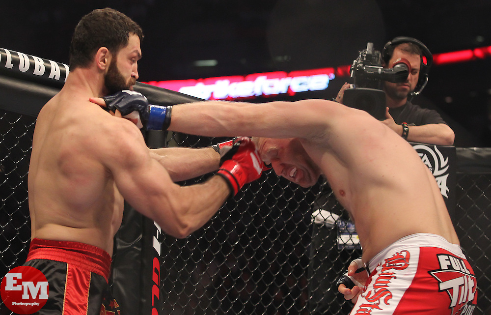 Feb 12, 2011; East Rutherford, NJ; USA; Andrei Arlovski (black/red trunks) and Sergei Kharitonov (red/white trunks) fight during their opening round bout of the Strikeforce Heavyweight Grand Prix at the IZOD Center in East Rutherford, NJ.  Kharitonov won via 1st round KO.