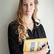 "Laurie Pickard, inside her Alexandria apartment, on Thursday, August 31, 2017. Pickard earned an M.B.A utilizing free online courses from a variety of prestigious universities. Furthermore, she started a website called nopaymba.com that is a resource for anyone seeking to do the same. Her book, called ""Don't Pay for Your M.B.A"" will be published in October. CREDIT: John Boal for The Wall Street Journal"