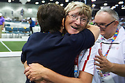 SO Poland athletes (L) Barbala Zapala and (R) Rafal Bednarczyk celebrate victory with their trainer coach at bocce competition during seventh day of the Special Olympics World Games Los Angeles 2015 on July 31, 2015 at South Hall of Convention Centre  in Los Angeles, USA.<br /> <br /> USA, Los Angeles, July 31, 2015<br /> <br /> Picture also available in RAW (NEF) or TIFF format on special request.<br /> <br /> For editorial use only. Any commercial or promotional use requires permission.<br /> <br /> Adam Nurkiewicz declares that he has no rights to the image of people at the photographs of his authorship.<br /> <br /> Mandatory credit:<br /> Photo by &copy; Adam Nurkiewicz / Mediasport