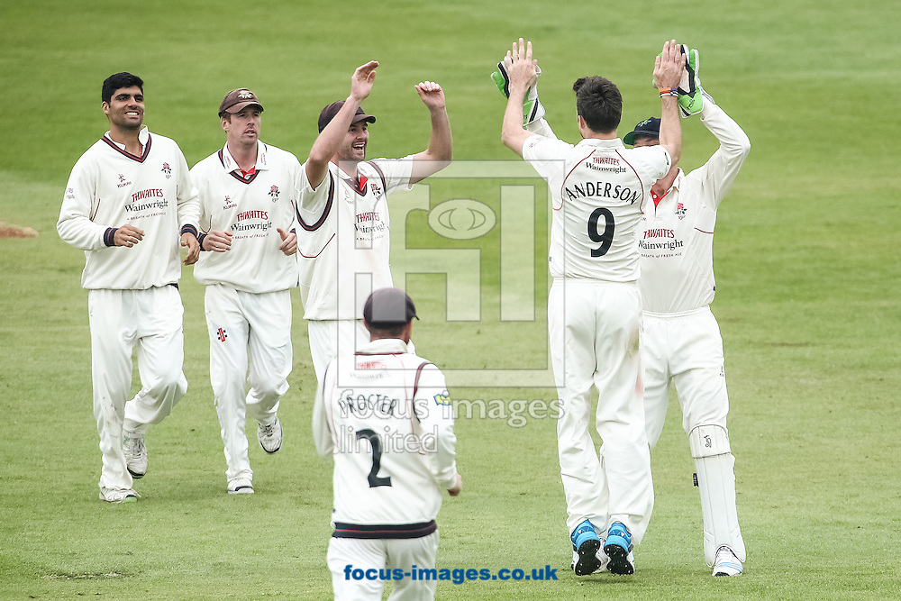 James Anderson (no. 9) is congratulated by his teammates on taking a wicket during the LV County Championship Div One match at the County Ground, Northampton. <br /> Picture by Andy Kearns/Focus Images Ltd 0781 864 4264  29/04/2014