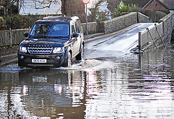 ©Licensed to London News Pictures 23/12/2019. <br /> Eynsford ,UK.High water level at Eynsford ford as a 4x4 drives in flood water. The River Darent water levels have continued to rise this morning causing flooding to parts of Eynsford Village in Kent. Photo credit: Grant Falvey/LNP