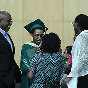 Family and friends gather together in the lobby after Wilmington University commencement exercise Sunday, May 17, 2015, at Chase Center On The Riverfront in Wilmington Delaware.