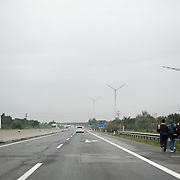 Morning, Tuesday 15th of September 2015. On the motorway to Vienna we see a group of Afghan teenagers who could't afford a Taxi ride to Vienna. They walk on the hard shoulder.