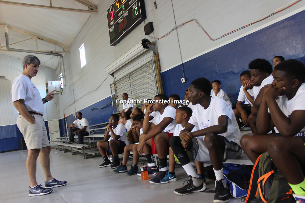 RAY VAN DUSEN/BUY AT PHOTOS.MONROECOUNTYJOURNAL.COM<br /> Itawamba Community College basketball coach Grant Pate, left, talks to participants of the Razzle Dazzle Basketball Camp, which was held last week at the Aberdeen Park and Recreations Building.