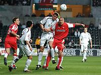 Photo: Adam Davies.<br /> Swansea City v Swindon Town. Coca Cola League 1. 11/04/2006.<br /> Swindon's Charlie Comyn-Platt and Swansea's Owain Tudor Jones challenge for the ball.
