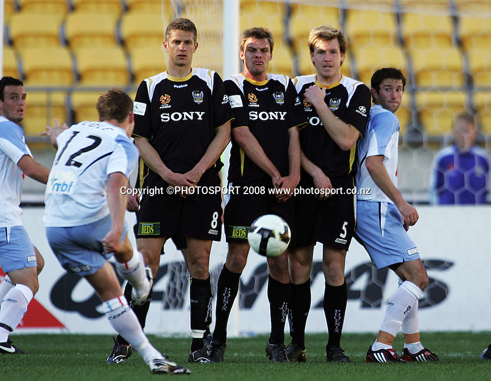 Shannon Cole's free kick drives straight into Phoenix' wall of Vaughan Coveny, Adam Kwasnik and Karl Dodd.<br /> A-League Round Six. Wellington Phoenix v Sydney FC at Westpac Stadium, Wellington. Sunday, 14 September 2008. Photo: Dave Lintott/PHOTOSPORT