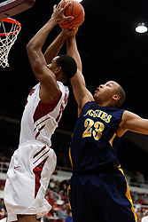 December 15, 2010; Stanford, CA, USA;  North Carolina A&T Aggies forward/center Thomas Coleman (23) blocks a shot by Stanford Cardinal forward/center Josh Owens (13) during the first half at Maples Pavilion.