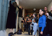 Jenny Wu (in blue) waits expectantly for the curtain to come down during the College of Education's K-12 art unveiling at McCracken Hall. Thursday, 1/18/07.