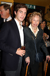 MR WILLIAM AITKEN son of Jonathan Aitken and his grand mother the HON.LADY AITKEN at a pre-screening party of a film by Fiona Sanderson entitled 'The Hunt For Lord Lucan' held at Langans, 254 Old Brompton Road, London SW7 on 8th November 2004.<br />