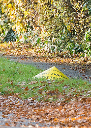© Licensed to London News Pictures. 27/11/2014. Fetcham, UK. Police evidence marker.  A manhunt is under way across two counties after a man and woman were found stabbed to death in Surrey. The bodies were found at a house in Fetcham, near Leatherhead, after Surrey Police were alerted in the early hours.. Photo credit : Stephen Simpson/LNP