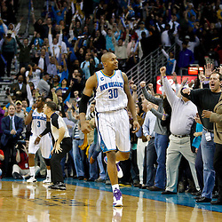 January 24,  2011; New Orleans, LA, USA; New Orleans Hornets power forward David West (30) celebrates with fans after hitting the game winning shot during the fourth quarter against the Oklahoma City Thunder at the New Orleans Arena. The Hornets defeated the Thunder 91-89. Mandatory Credit: Derick E. Hingle