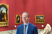 "FLORENCE, ITALY - 29 JUNE 2016: The new director of the Uffizi Gallery Eike Schmidt poses for a portait in the ""Michelangelo and the Florentines"" room at the Uffizi Gallery in Florence, Italy, on June 29th 2016.<br /> <br /> Art historian Eike Schmidt, former curator and head of the Department of Sculpture, Applied Art and Textiles at the Minneapolis Institute of Arts, became the first non-Italian director of the Uffizi in August 2015, replacing Antonio Natali who directed the gallery for 9 years. One of the main goals of the new director is to open the Vasari Corridor to the general public. Currently the corridor can only be visited with group reservations made by external tour and travel agencies throughout the year.<br /> <br /> The Vasari Corridor is is a 1-kilometer-long (more than half mile) elevated enclosed passageway which connects the Palazzo Vecchio with the Palazzo Pitti, passing through the Uffizi Gallery and crossing the Ponte Vecchio above the Arno River, in Florence. The passageway was designed and built in 1564 by Giorgio Vasari in only 6 months to allow Cosimo de' Medici and other Florentine elite to walk safely through the city, from the seat of power in Palazzo Vecchio to their private residence, Palazzo Pitti. The passageway contains over 1000 paintings, dating from the 17th and 18th centuries, including the largest and very important collection of self-portraits by some of the most famous masters of painting from the 16th to the 20th century, including Filippo Lippi, Rembrandt, Velazquez, Delacroix and Ensor."