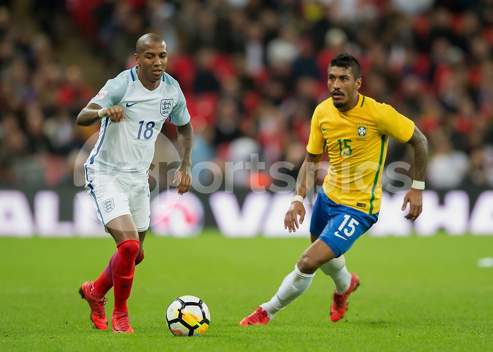 Ashley Young of England goes past Paulinho of Brazil during the International Friendly match between England and Brazil at Wembley Stadium, London, England on 14 November 2017. Photo by Vince Mignott.