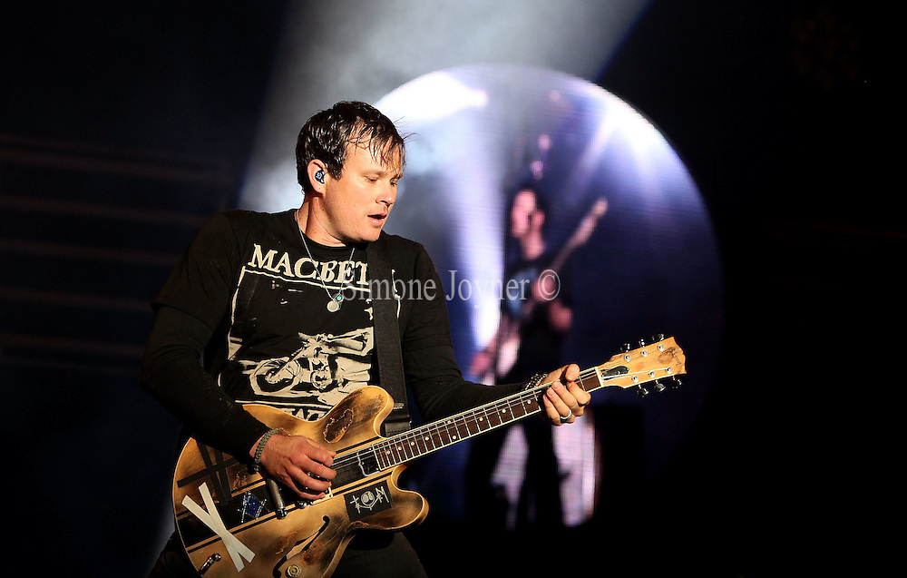 Tom Delonge of Blink 182 performs live on the Main stage during the third and final day of Reading Festival on August 29, 2010 in Reading, England.  (Photo by Simone Joyner)
