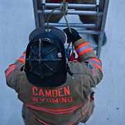 Camden-Wyoming Robin Andino secures a 24 foot ladder with rope during ladder training Wednesday, July 6, 2011, in Camden-Wyoming Delaware.