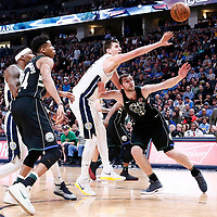 01 April 2018: Denver Nuggets center Nikola Jokic (15) vies for the rebound with Milwaukee Bucks center Tyler Zeller (44) during the Denver Nuggets 128-125 victory over the Milwaukee Bucks, at the Pepsi Center, Denver, Colorado, USA.