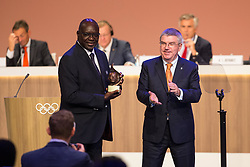 LIMA, Sept. 16, 2017  International Olympic Committee (IOC) President Thomas Bach (R) congratulates IOC honour member Youssoupha Ndiaye during the 131st IOC session in Lima, Peru, on Sept. 15, 2017. The 131st IOC session concluded on Friday. (Credit Image: © Li Ming/Xinhua via ZUMA Wire)