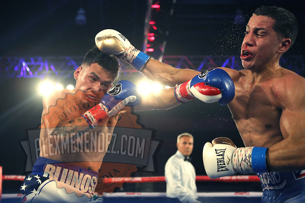 """KISSIMMEE, FL - MAY 25: Adam Lopez punches Jean Carlos """"Chapito"""" Rivera during their Jr. NABF Featherweight Title fight at Osceola Heritage Park on May 25, 2019 in Kissimmee, Florida. (Photo by Alex Menendez/Getty Images) *** Local Caption *** Jean Carlos Rivera; Adam Lopez"""