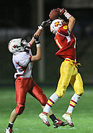Marion's Quinn Cannoy (11) pulls in the game winning touchdown as Western Dubuque's Riley Pfieler (5) defends during their first round playoff game at Thomas Park Field in Marion on Wednesday, October 24, 2012.