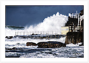 A crashing white wave contrasts with the dark sky as an east coast low pressure system pounds the Sydney coastline [Bronte Baths, NSW]<br />