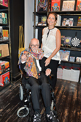 ALAN ALDRIDGE and his daughter SAFFRON ALDRIDGE at a private view of You Say You Want A Revolution: Records and Rebels 1966-1970 at the V&A, London on 7th September 2016.