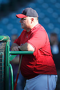 ANAHEIM, CA - AUGUST 18:  Manager Mike Scioscia #14 of the Los Angeles Angels of Anaheim watches batting practice during the game against the Texas Rangers on August 18, 2011 at Angel Stadium in Anaheim, California. The Angels won the game 2-1. (Photo by Paul Spinelli/MLB Photos via Getty Images) *** Local Caption *** Mike Scioscia