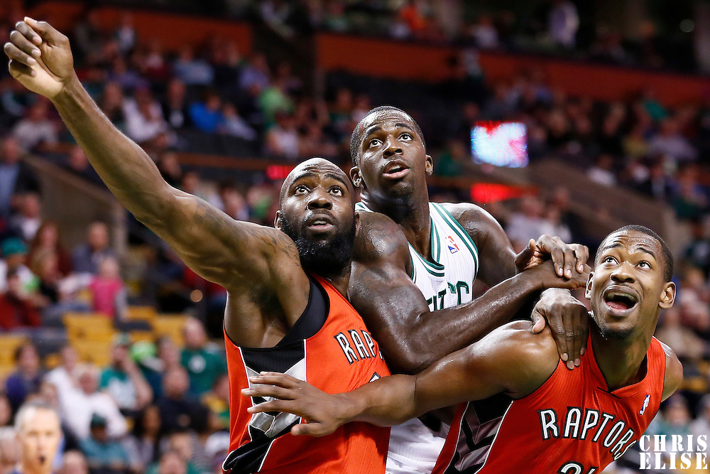17 November 2012: Toronto Raptors small forward Quincy Acy (4) vies for the rebound with Boston Celtics power forward Brandon Bass (30) and Toronto Raptors shooting guard Terrence Ross (31) during the Boston Celtics 107-89 victory over the Toronto Raptors at the TD Garden, Boston, Massachusetts, USA.