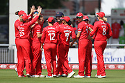 Lancashire Thunder celebrate the first wicket during the Women's Cricket Super League match between Lancashire Thunder and Surrey Stars at the Emirates, Old Trafford, Manchester, United Kingdom on 7 August 2018.